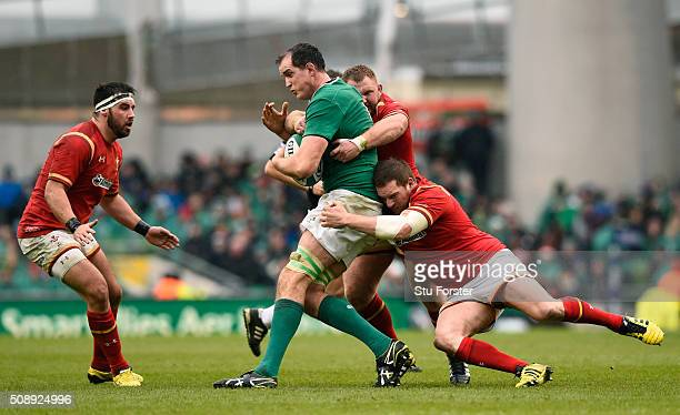 Devin Toner of Ireland is tackled by Samson Lee and Gethin Jenkins of Wales during the RBS Six Nations match between Ireland and Wales at the Aviva...