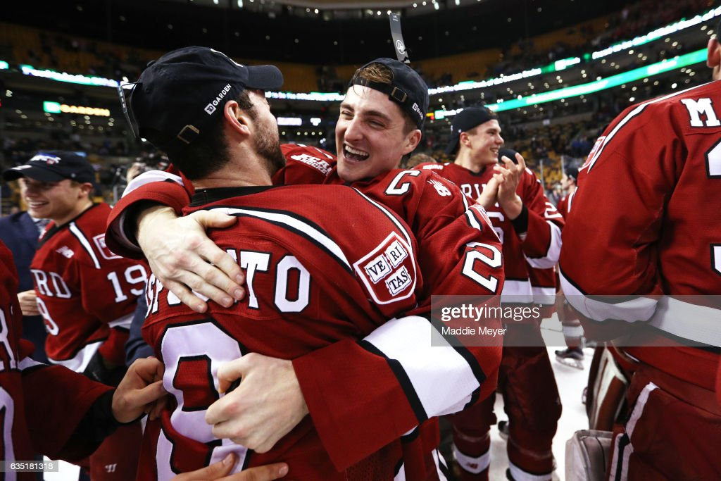 Devin Tringale #22 of the Harvard Crimson and Luke Esposito #9 celebrate after defeating Boston University Terriers 6-3 in the 2017 Beanpot Tournament Championship at TD Garden on February 13, 2017 in Boston, Massachusetts.