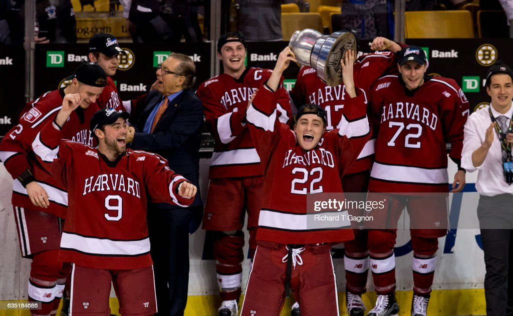 Devin Tringale #22 of the Harvard Crimson celebrates with his teammates after beating the Boston University Terriers during NCAA hockey in the championship game of the annual Beanpot Hockey Tournament at TD Garden on February 13, 2017 in Boston, Massachusetts. The Crimson won the game 6-3 and captured its first Beanpot Championship since 1993.