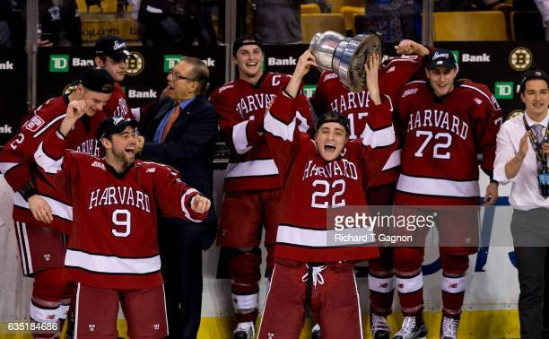 Devin Tringale of the Harvard Crimson celebrates with his teammates after beating the Boston University Terriers during NCAA hockey in the...