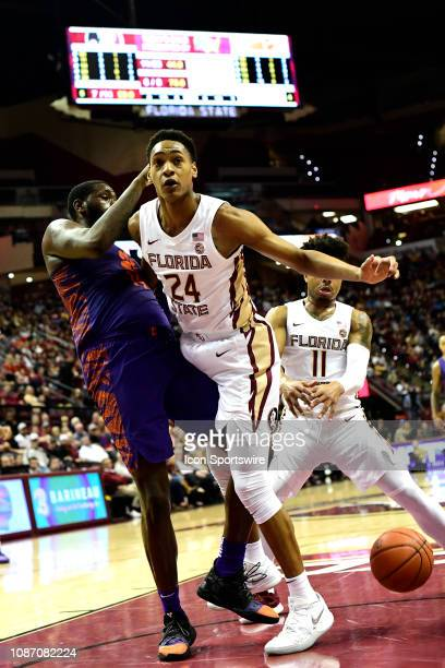 Devin Vassell guard/forward Florida State University Seminoles loses the basketball as he is kneed in the groin by Elijah Thomas forward Clemson...