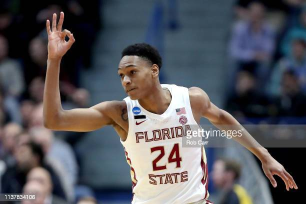 Devin Vassell of the Florida State Seminoles celebrates his basket against the Murray State Racers in the first half during the second round of the...