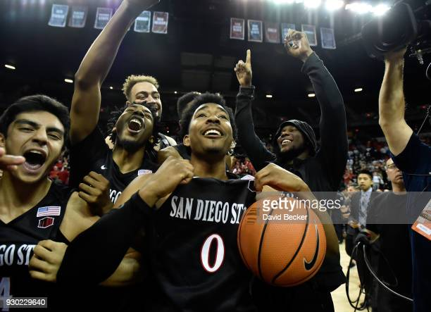 Devin Watson of the San Diego State Aztecs celebrates with teammates the victory over the New Mexico Lobos after the championship game of the...