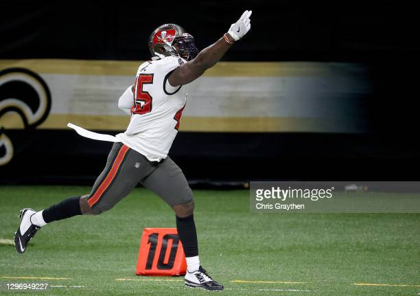 Devin White of the Tampa Bay Buccaneers celebrates after intercepting a pass thrown by Drew Brees of the New Orleans Saints during the fourth quarter...