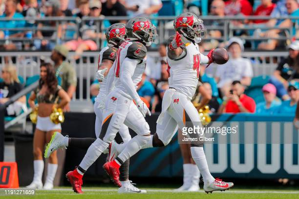 Devin White of the Tampa Bay Buccaneers celebrates an interception during the first quarter of a game against the Jacksonville Jaguars at TIAA Bank...