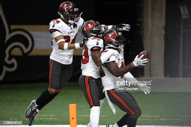 Devin White of the Tampa Bay Buccaneers celebrates with his teammates after intercepting a pass thrown by Drew Brees of the New Orleans Saints during...