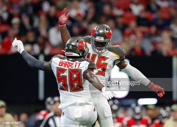 Devin White of the Tampa Bay Buccaneers reacts after sacking Matt Ryan of the Atlanta Falcons in the first half with Shaquil Barrett at Mercedes-Benz...