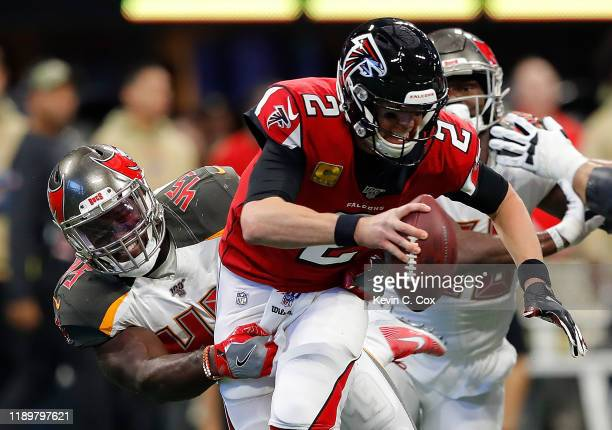 Devin White of the Tampa Bay Buccaneers sacks Matt Ryan of the Atlanta Falcons in the first half at MercedesBenz Stadium on November 24 2019 in...