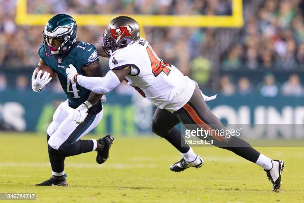 Devin White of the Tampa Bay Buccaneers tackles Kenneth Gainwell of the Philadelphia Eagles at Lincoln Financial Field on October 14, 2021 in...