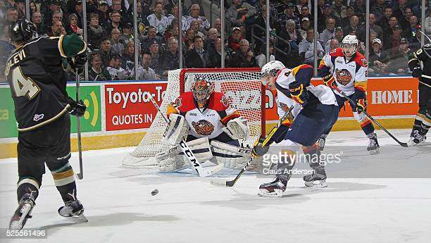 Devin Williams of the Erie Otters gets set to face a shot from Olli Juolevi of the London Knights during game four of the OHL Western Conference...