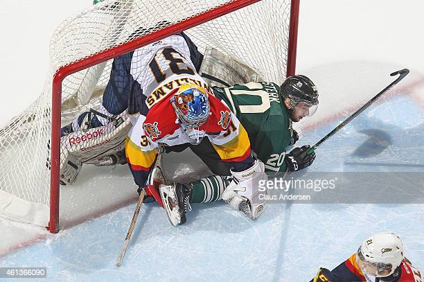 Devin Williams of the Erie Otters is knocked over by Josh Sterk of the London Knights in an OHL game at Budweiser Gardens on January 9 2015 in London...