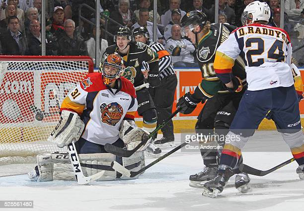 Devin Williams of the Erie Otters stops a scoring attempt by Christian Dvorak of the London Knights during game four of the OHL Western Conference...