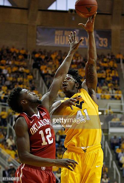 Devin Williams of the West Virginia Mountaineers takes a shot over Khadeem Lattin of the Oklahoma Sooners during the game at the WVU Coliseum on...