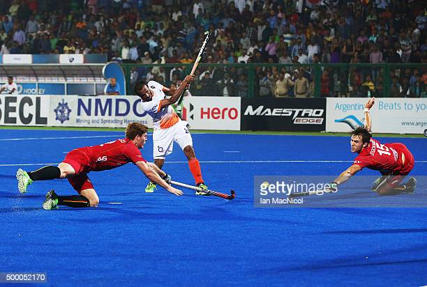 Devindar Walmiki of India shoots at goal during the match between India and Belgium on day nine of The Hero Hockey League World Final at the Sardar...