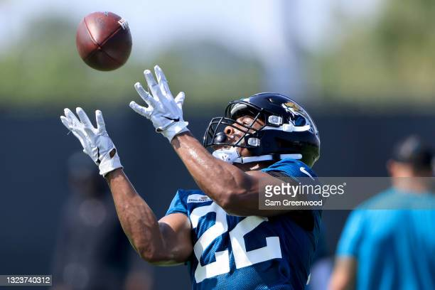 Devine Ozigbo of the Jacksonville Jaguars attempts a reception during Jacksonville Jaguars Mandatory Minicamp at TIAA Bank Field on June 15, 2021 in...