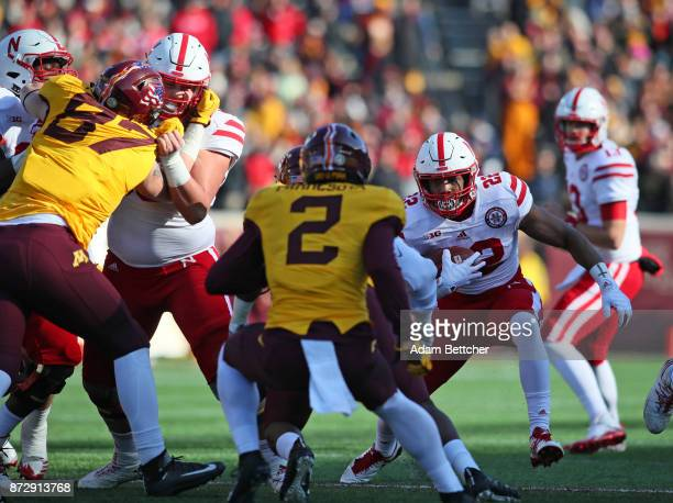 Devine Ozigbo of the Nebraska Cornhuskers carries the ball for a gain in the first quarter against the Minnesota Golden Gophers at TCF Bank Stadium...