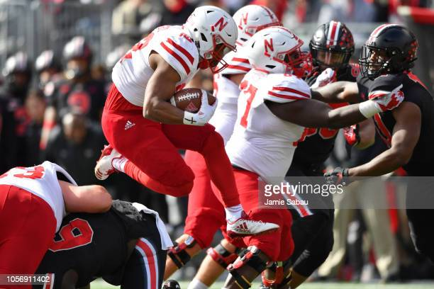 Devine Ozigbo of the Nebraska Cornhuskers leaps through the line of scrimmage to pick up yardage in the second quarter against the Ohio State...