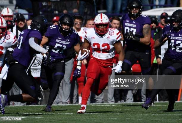 Devine Ozigbo of the Nebraska Cornhuskers runs against the Northwestern Wildcats during the first half on October 13 2018 at Ryan Field in Evanston...