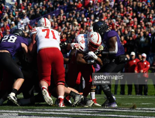 Devine Ozigbo of the Nebraska Cornhuskers scores a touchdown against the Northwestern Wildcats during the second half on October 13 2018 at Ryan...