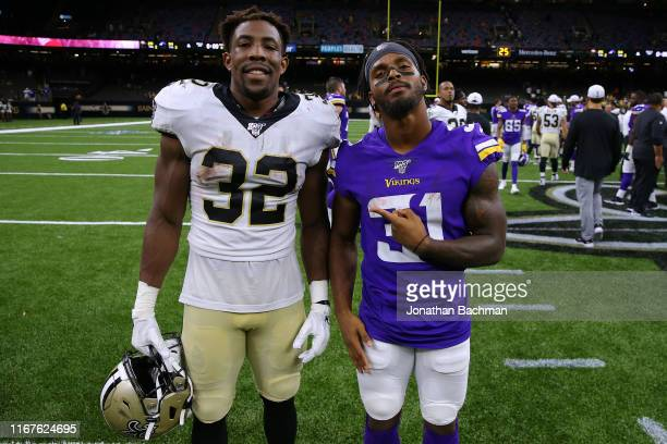 Devine Ozigbo of the New Orleans Saints and Ameer Abdullah of the Minnesota Vikings after a preseason game at the Mercedes Benz Superdome on August...
