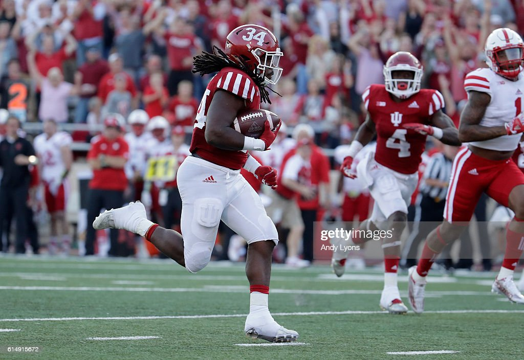 Devine Redding #34 of the Indiana Hoosiers runs for a touchdown during the game aganst the Nebraska Cornhuskers at Memorial Stadium on October 15, 2016 in Bloomington, Indiana.