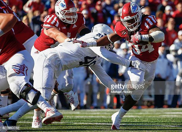 Devine Redding of the Indiana Hoosiers runs the ball as Shareef Miller of the Penn State Nittany Lions tries to make the tackle at Memorial Stadium...