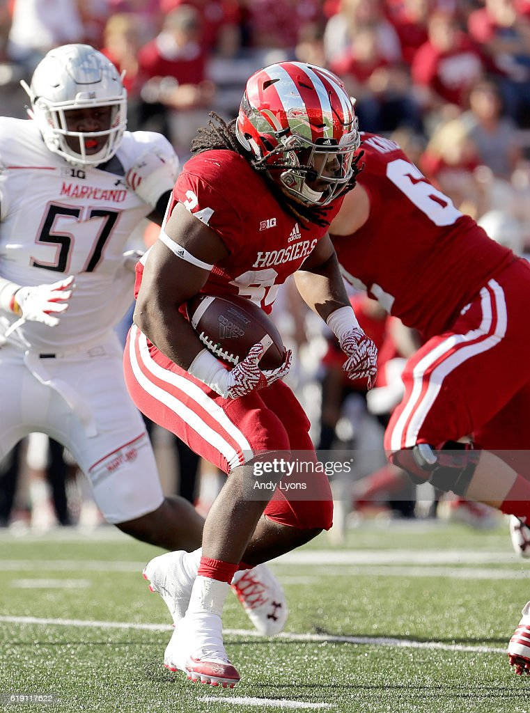 Devine Redding #34 of the Indiana Hoosiers runs with the ball in the game against the Maryland Terrapins at Memorial Stadium on October 29, 2016 in Bloomington, Indiana.