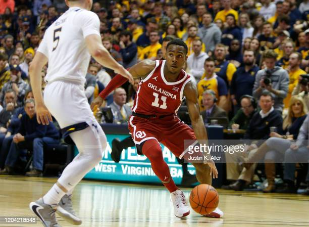 De'Vion Harmon of the Oklahoma Sooners drives against the West Virginia Mountaineers at the WVU Coliseum on February 29 2020 in Morgantown West...