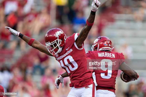 De'Vion Warren celebrates after catching a touchdown pass with Jordan Jones of the Arkansas Razorbacks in the second half during a game against the...