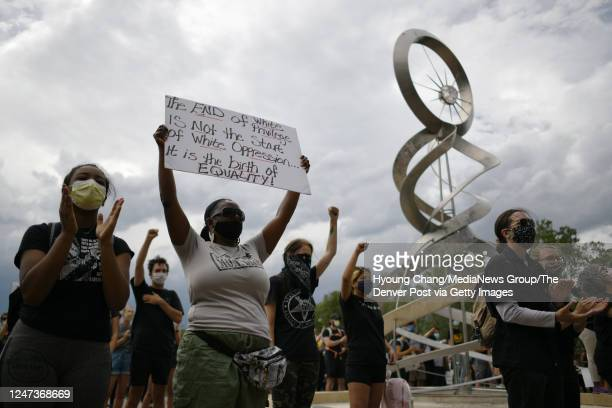 Devionne Fugett and her mother MiDian Holmes take part in a gathering to decry the death and honor the life of Elijah McClain in Aurora Colorado on...