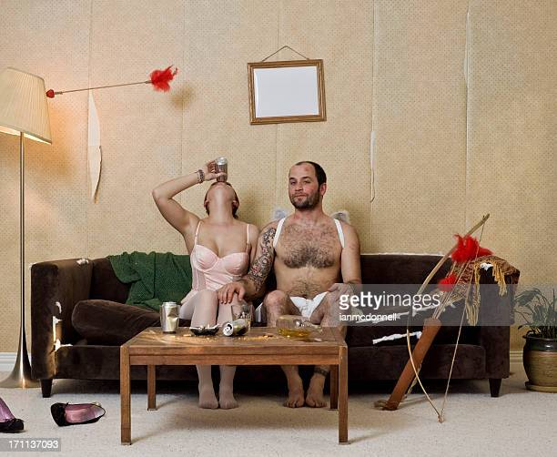 devious cupid and woman - naughty valentine stockfoto's en -beelden