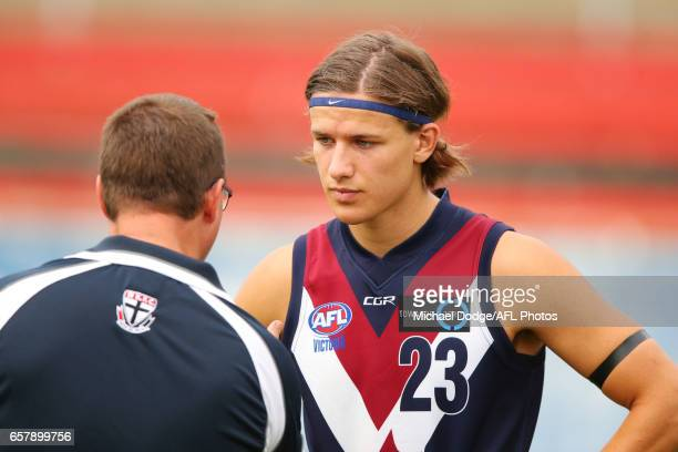 Devlin Brereton of the Sandringham Dragons son of Hawthorn Hawks Legend Dermott Brereton listens to a coach during the 2017 TAC round 01 match...