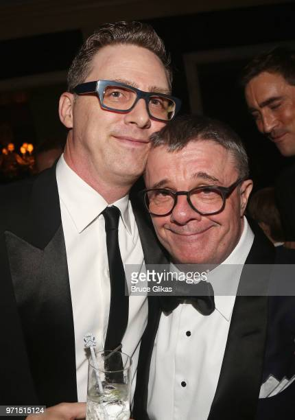 Devlin Elliott and husband Nathan Lane pose at the 2018 OM Private Tony After Party at The Carlysle Hotel on June 10 2018 in New York City