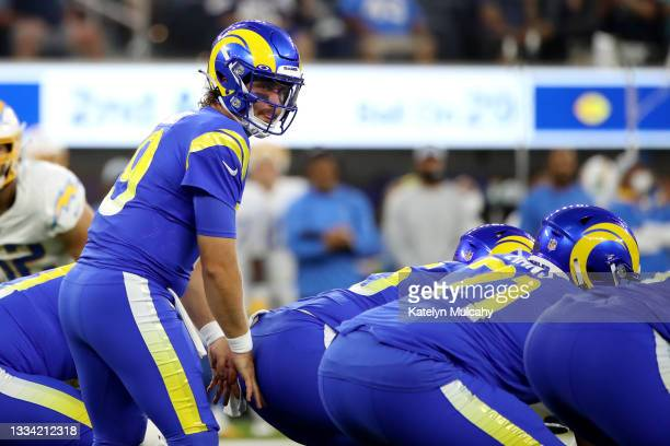 Devlin Hodges of the Los Angeles Rams looks on before the snap against the Los Angeles Chargers during the first quarter during the preseason game at...