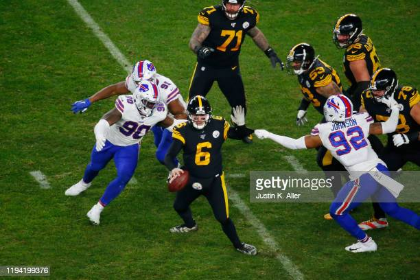 Devlin Hodges of the Pittsburgh Steelers attempts to escape pressure during the second half against the Buffalo Bills in the game at Heinz Field on...
