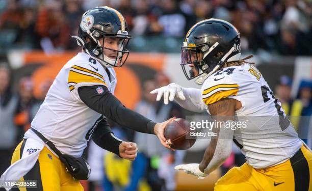 Devlin Hodges of the Pittsburgh Steelers hands the ball off to Benny Snell Jr. #24 of the Pittsburgh Steelers during the fourth quarter of the game...