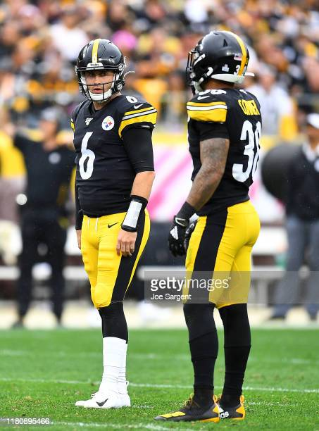 Devlin Hodges talks with James Conner of the Pittsburgh Steelers during the game against the Baltimore Ravens at Heinz Field on October 6 2019 in...
