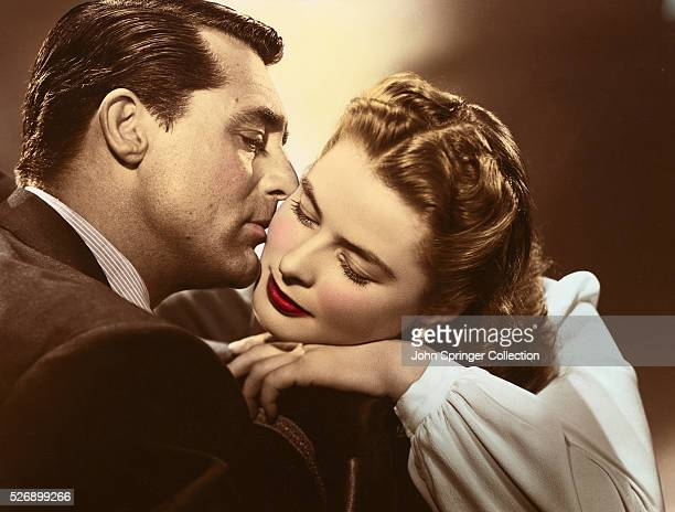 Devlin kisses the cheek of Alicia Huberman in a publicity still for Notorious.