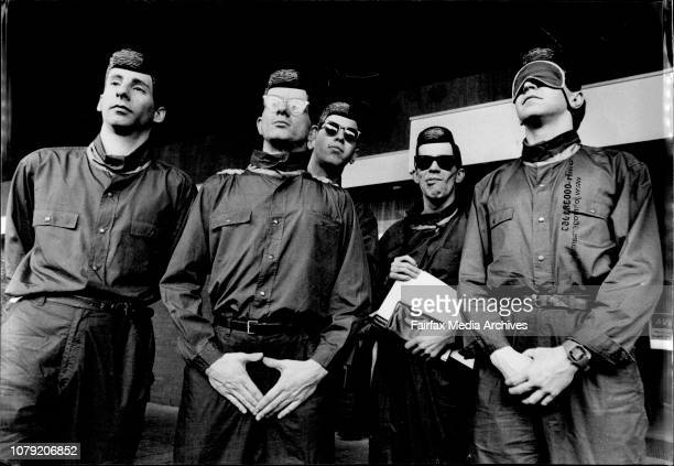 Devo arrived in Sydney today looking like they had stepped out of a shop store window rather than JumboThey posed for fans and press before boarding...