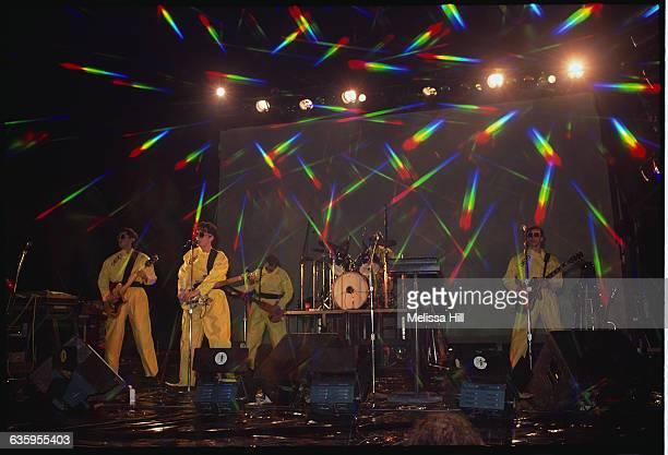Devo Performing in Yellow Plastic Coveralls