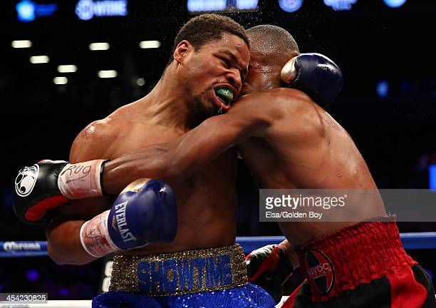 Devon Alexander and Shawn Porter clinch in the center of the ring during their IBF Welterweight title fight at Barclays Center on December 7, 2013 in...