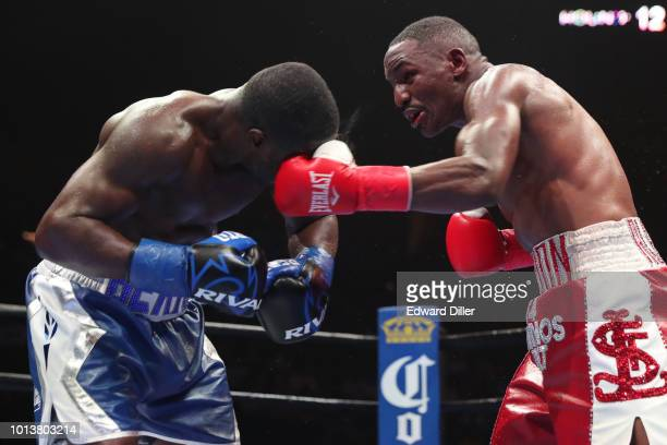 Devon Alexander lands a left hand against Andre Berto Berto would win by split decision at the Nassau Veterans Memorial Coliseum on August 4 2018 in...
