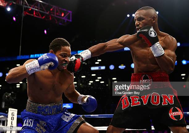 Devon Alexander punches Shawn Porter during their IBF Welterweight title fight at Barclays Center on December 7, 2013 in the Brooklyn borough of New...