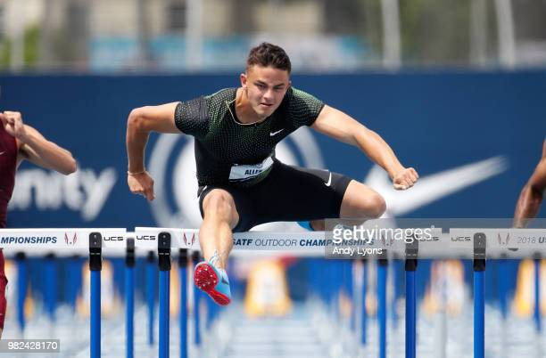Devon Allen clears a hurdle in the opening round of the Mens 110 Meter Hurdles during day 3 of the 2018 USATF Outdoor Championships at Drake Stadium...