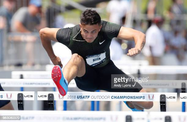 Devon Allen clears a hurdle in the semifinal of the Mens 110 Meter Hurdles during day 4 of the 2018 USATF Outdoor Championships at Drake Stadium on...
