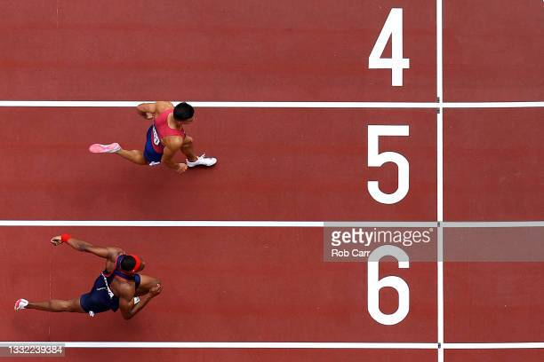 Devon Allen of Team United States finishes ahead of Aurel Manga of Team France in the Men's 110m Hurdles Semi-Final on day twelve of the Tokyo 2020...