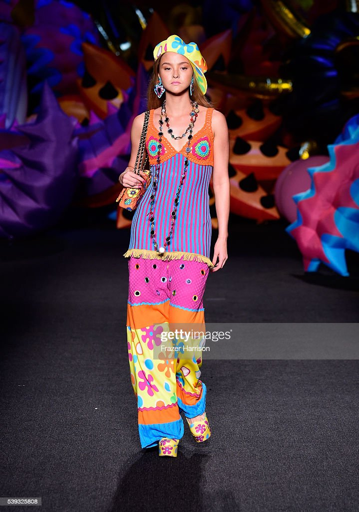 Devon Aoki walks the runway at the Moschino Spring/Summer 17 Menswear and Women's Resort Collection during MADE LA at L.A. LIVE Event Deck on June 10, 2016 in Los Angeles, California.