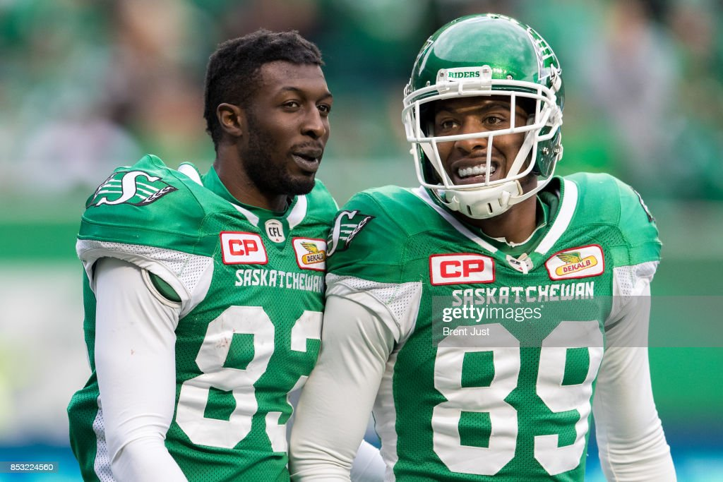 Devon Bailey #83 and Duron Carter #89 of the Saskatchewan Roughriders celebrate after a touchdown in the game between the Calgary Stampeders and Saskatchewan Roughriders at Mosaic Stadium on September 24, 2017 in Regina, Canada.