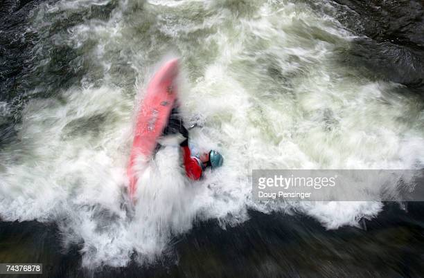 Devon Barker emerges from the froth as she competes in the Women's Kayak Pro Freestyle Qualifier in Whitewater Park on Gore Creek during The Teva...