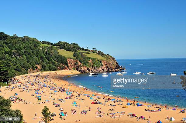 devon beach - crowded beach stock pictures, royalty-free photos & images